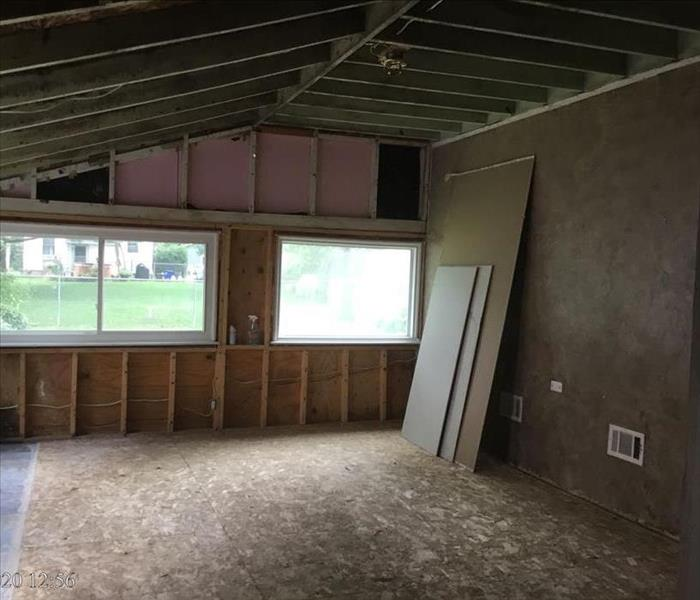 Rec room with carpet and pad removed along with no wood ceiling and drywall walls removed