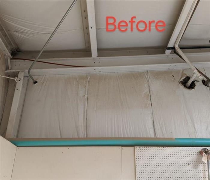 Commercial building with soot and dust on insulation and pipe