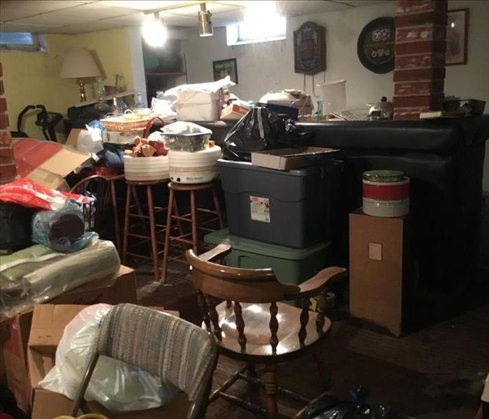 Lots of items clutter the space, the walls and floor are not visible in the room