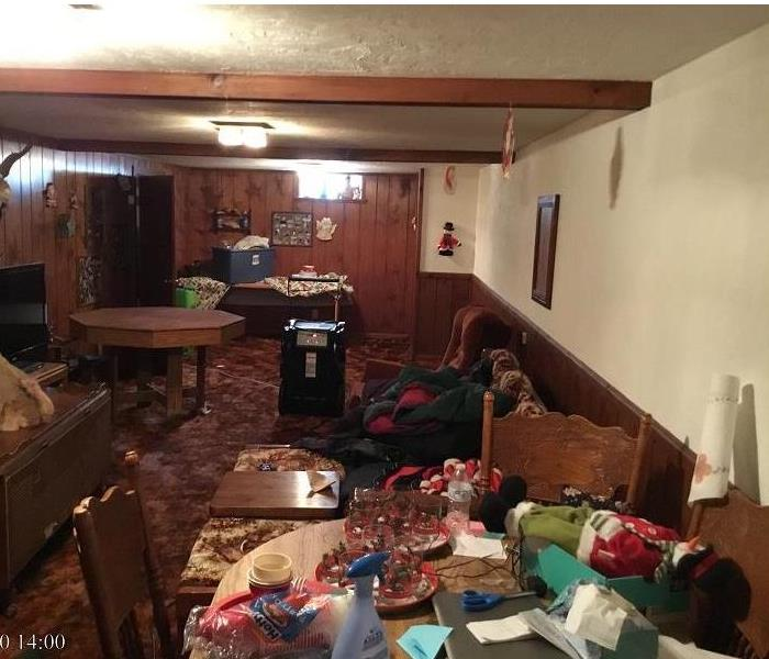 A customers belongings are in a room affected by water