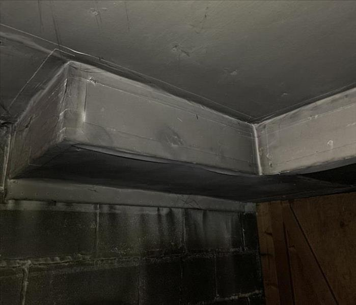 Ductwork in Basement wrapped in insulation full of smoke damage after a fire