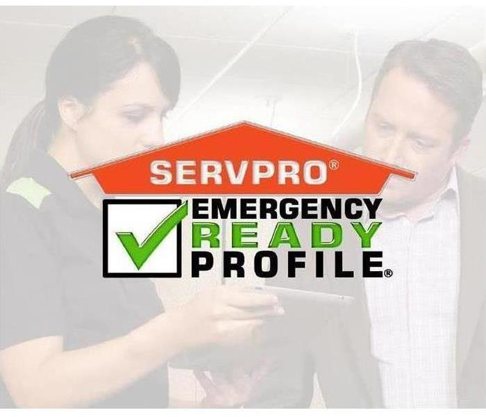 "Two people looking at a clip board in the background.  Foreground is the SERVPRO logo with the words ""Emerency Ready Profile"""