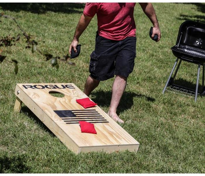 Man playing Cornhole